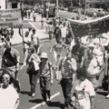 Met Council on Housing at an anti-Apartheid rally (1986).