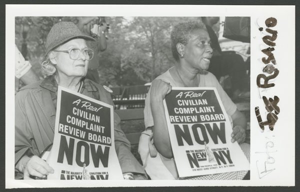 Women hold signs for a Civilian Complaint Review Board (undated).